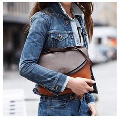 denim jacket and leather clutch #minimalist #fashion +NEVER BEEN A DENIM ON DENIM FAN BUT THIS IS FAB!