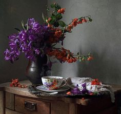 Still life with  flowers and a cup of tea.
