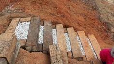 Railroad tie steps with decorative stones