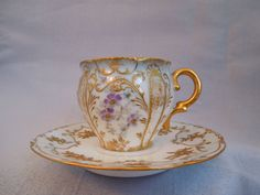 Limoges Porcelain~ Demitasse Cup And Saucer~ Raised Gold~ Floral Pattern. 1920.