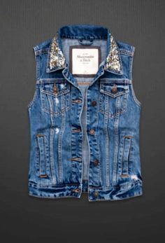 A embellished distressed denim vest!! super hot classic must have piece for your wardrobe 2013!