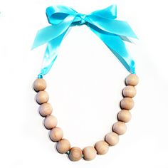 "DIY style maven stringing beads toy and wooden necklace in one! Our current favorite ""craft"" at home ;)"