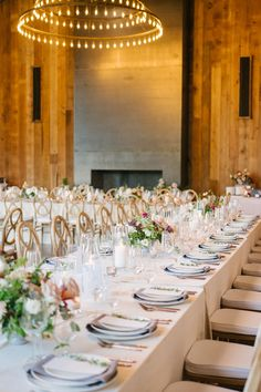 """From the editorial """"The Perfect Blend of Rustic & Romantic at Brasswood Bar + Kitchen in Northern California."""" The huge fireplace, oversized round chandeliers, and floral design are some of our favorite elements that brought this classic barn wedding to life. Photography: @erinheartscourt #rusticreception #rusticwedding #rusticweddingdecor #weddingdetails #weddingdesign Romantic Wedding Receptions, Wedding Reception Design, Barn Wedding Venue, Wedding Reception Decorations, Reception Ideas, Wedding Decor, Round Chandelier, Chandeliers, Romantic Wedding Centerpieces"""