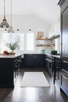 Shiplap wall detail and colored cabinets.