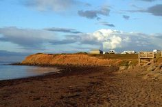 Murray Beach Provincial Park, located on New Brunswick's Northumberland Strait, offers coastal camping with breathtaking sunrises and sunsets. Hopewell Rocks, New Brunswick Canada, Whale Watching Tours, Atlantic Canada, Hiking Tours, Small Waterfall, Picnic Area, Canada Travel, Staycation