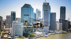 Blackhawk helicopters fly over Brisbane on exercise ahead of the G20.
