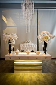 Bridal table decorated with Hydrangeas, Phalaenopsis Orchids and Peony