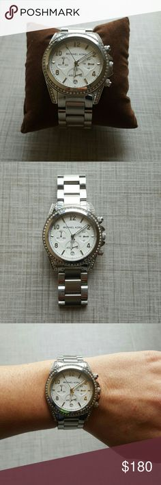 Michael Kors Silver Watch Michael Kors oversized silver watch with diamond detailing. No missing diamonds, only sign of wear is on closure clasp as pictured. Needs a new battery. Comes with pillow, extra links, but I can't find the top to the storage box. No trades. Michael Kors Accessories Watches