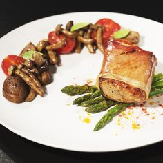 Savory pork tenderloin wrapped in prosciutto and baked in the oven… Already drooling? Just wait till you see what's on the side… Butter fried asparagus and mushrooms seasoned with garam masala and just a splash of soy sauce. It's a pretty exotic dish and a true adventure for your taste buds.