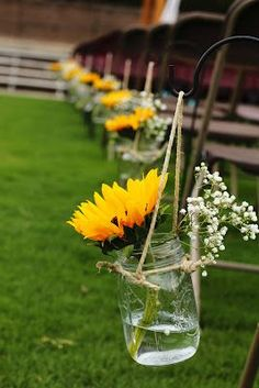 Ceremony: aisle decorations - mason jars with twine loops to hang on shepherd's hooks - don't like the sunflowers, I would do all baby's breath.