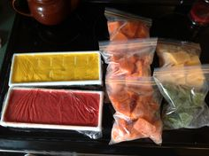 Homemade baby food. Purée fruits and veggies and pour into ice cube trays. Transfer to freezer bags when frozen for easy storage!