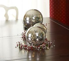 @Lisa Robertson QVC picked these beautiful mercury glass balls as one of her favorite holiday decor items this week. They look so pretty here as a centerpiece on this dark table  #AlltheJoy