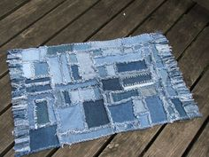 Repurposed denim patchwork throw rug.  Would be great for