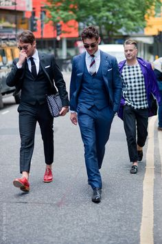 I think David Gandy (centre) is looking super cool in this classic suit that fits like a glove. The shades really help keep the overall look feeling fresh and modern.  {via streetstyleaesthetic}
