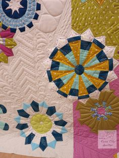 Quilting by Rose City Quilter. Bloomin' Cogwheels is a pattern book at shop.blocloc.com