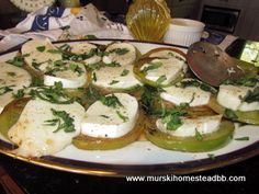 Getting toward the end of summer be sure to use those green tomatoes and garden basil!  This is a great al fesco dish with grilled green tomatoes, fresh mozzarella, fresh basil, garlic, balsamic vinegar, salt & pepper...find the recipe on our  blog.  So good with a crisp chardonnay and rustic french bread!