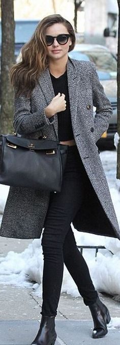 Miranda Kerr: Jeans – Frame Denim  Shoes and coat – Saint Laurent  Purse – Hermes