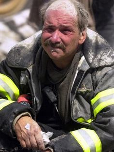 Looks like a New Yorker, tough like a New Yorker, devastated like every New Yorker was on 9/11.  30 pictures of 9/11 that show you why you should never forget