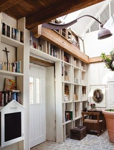 Good use of space; also, nice natural light... I want an indoor/outdoor tree someday.