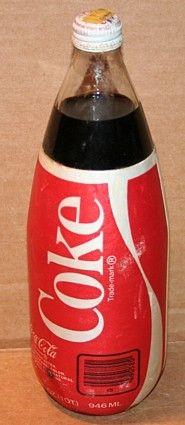 Coca-Cola glass bottle with foam label.
