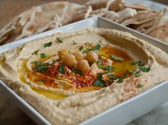 Homemade hummus is much tastier and healthier, and is made from ingredients you can keep readily on hand — a few cans of chickpeas, extra virgin olive oil, a scoop of tahini, freshly squeezed lemon juice, garlic and spices. Just give it all a whirl in the food processor and you're done.