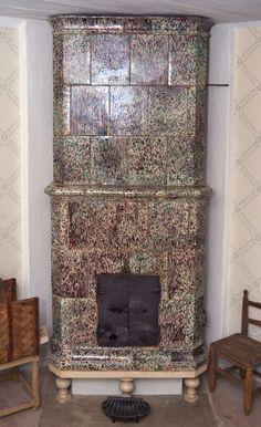 Poêle en faïence suédois fin XVIIIe à Kristianopel en Scanie. Décor moucheté (oxyde de manganèse) imitant le marbre .