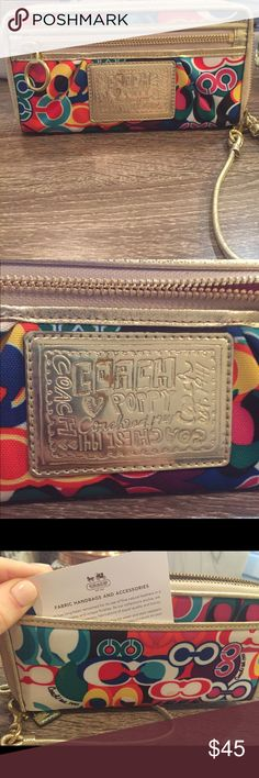 """Authentic Coach Poppy Wallet (full-size) Great condition, just normal """"wear and tear"""" in one spot on the front label (pictured- the """"O"""" in Coach) and minor spot on the back. Matching Tote bag available in separate listing if you'd like both. Coach Bags Wallets"""