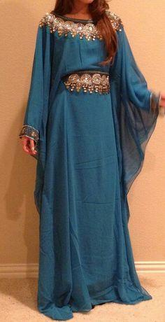 Woaaw ❤ Navy blue Abaya :o Jewel-like design on waist and shoulder .