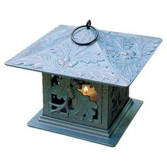 """Handmade recycled aluminum candle lantern in oil rubbed bronze with an oak leaf motif.  Product: LanternConstruction Material: Recycled aluminum and glassColor: Copper verdigrisFeatures:  Hand-paintedRust proofHand cast Accommodates: (1) Candle - not includedDimensions: 9.5"""" H x 9.5"""" W x 9.5"""" D"""