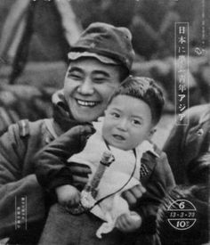 Japanese army Lance Corporal hugging little child before being departed to the front in China (1938)