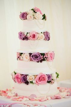 "Pretty purple and pink wedding cake. Creative idea to use tiers for flowers only. We can help achieve this look at Dallas Foam with cake dummies, cupcake stands and cakeboards. Just use ""Pinterest2013"" as the item code and receive 10% off @ www.dallas-foam.com #purpleweddingcakes"