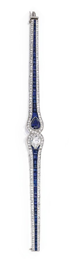 PLATINUM, SAPPHIRE AND DIAMOND BRACELET, COVEN-LACLOCHE, FRANCE.  Centered by a pear-shaped diamond weighing approximately 1.95 carats and a pear-shaped sapphire weighing approximately 2.35 carats, flanked by a row of calibré-cut sapphires and bordered by single-cut diamonds weighing approximately 4.00 carats, length 7¼ inches, signed Coven-Lacloche, numbered 4418, with French assay and workshop marks; circa 1925.
