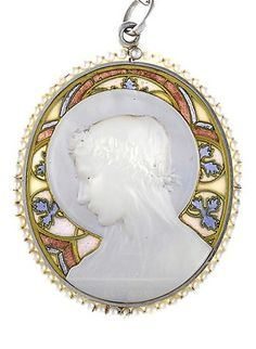 Antique mother-of-pearl, seed pearl, and plique-à-jour enamel pendant with chain, Frédéric de Vernon, French, circa 1910. Depicting the bust of a female saint; signed F Vernon; with French assay marks; mounted in eighteen karat gold and platinum.