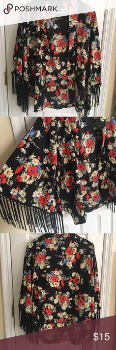 NWOT Floral Kimono Super cute never worn floral kimono. Fringe detailing at the bottom of each bell sleeve fun & flirt Tops