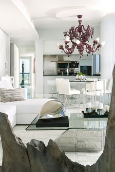 LIGHTING - modern Miami condo design. Bold chandelier in a all white