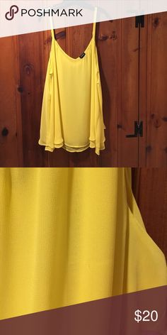 Double layer can I from Torrid Buttercup yellow double layer cami size 3 from Torrid. There is a teeny pull on the front you can barely see. Worn once - hand washed, hang dry and steamed. torrid Tops Tank Tops