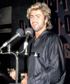 """21-year-old George Michael becomes the youngest recipient of an Ivor Novello songwriting award in London, 1985. Presenting it, Elton John had hailed him as """"a major songwriter in the tradition of Paul McCartney and Barry Gibb""""."""