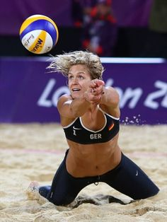 Laura Ludwig of Germany dives for the ball during the women's Beach Volleyball quarter Final match between Brazil and Germany on Day 9 at Horse Guards Parade