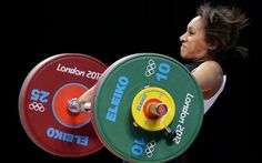 Zoe Smith of Great Britain competes during the women's 58-kg, group B, weightlifting competition and breaks British record!