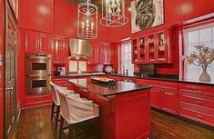 Glittering chandeliers and a bright red kitchen!