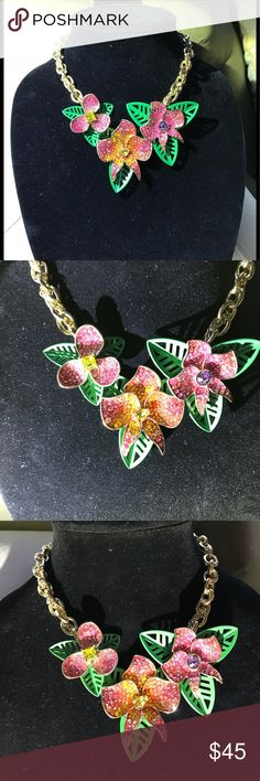 Betsey Johnson embellished Necklace (Host Pick)  Fabulous flowers and quality chain.lobster claw  closure. beautifully designed flowers lots of sparkle. Pink yellow and purple. Betsy Johnson heart charm dangling in back adjustable chain. New with tags Betsey Johnson Jewelry Necklaces