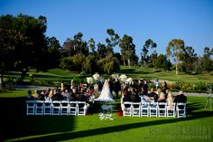 Gorgeous outdoor ceremony on the lawn at this Marbella Country Club Wedding | Jim Kennedy Photographers