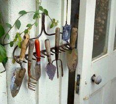 Cute & useful way to reuse a broken rake.