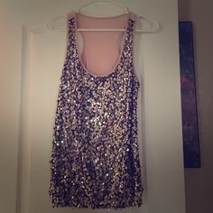 Sparkle Fashion Tunic Super cute tunic, perfect for any night out with friends! You get just the right amount of attention with the glamour of the shimmer look, yet sophisticated and in style! Tops Tunics