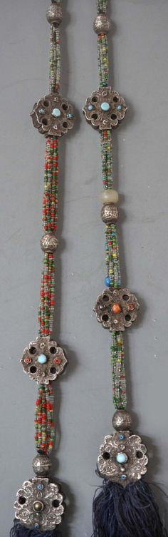 Full length of Uighur braid ornament, silver inlaid with turquoise , coral, black pearl, strung on glass beads, with silk tassels. Fine granulation. .Xinjiang Province (private collection Linda Pastorino)