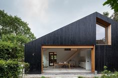 Workshop Architecten has created blackened wood barn for a farm in the Netherlands, which is divided into separate living quarters for sheep and people house architecture, Black wood barn by Workshop Architecten houses livestock and people Contemporary Barn, Modern Barn, Residential Architecture, Modern Architecture, Chinese Architecture, Timber Cladding, House Extensions, Black House, House In The Woods