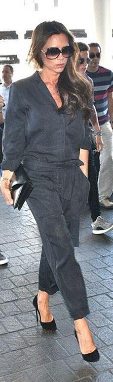 Victoria Beckham: Jumpsuit and purse – Victoria Beckham Collection  Shoes – Casadei