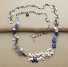 """$390.00 Deep blue lapis is the centerpiece of our eclectic necklace combining labradorite, chalcedony, moonstone, kyanite and cultured keishi pearls with leather and oxidized sterling accents. Sterling silver toggle closure. Approx. 28""""L."""