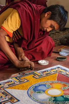 Portrait Tibetan buddhist monk creating colourful mandala - Leh, Inda - travel photography by RafLeszczynskiPhotos