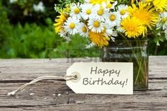 fiori compleanno: fiori selvatici con carta di compleanno
